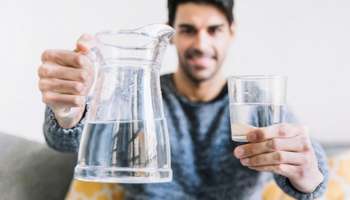 man holding a pitcher of water